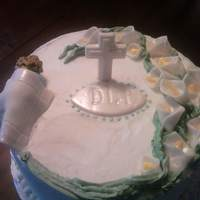 Baptism Cake Everything is edible except the toothpick holding up the cross. Decorations are made out of white chocolate clay and butter cream, smoothed...
