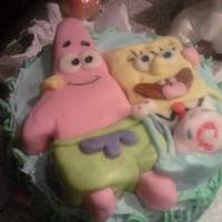 Sponge Bob And Friends Chocolate cake with carved brownie characters, covered in rolled butter-cream fondant