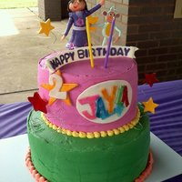 Princess Dora And Boots Made this for my niece's 2nd birthday party. She loves dora! First time I have ever done ALL buttercream. Dora ,Boots Stars and...
