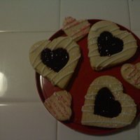 Vday Cookies raspberry jam filled sugar cookies with white chocolate drizzle