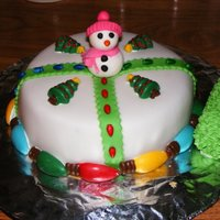 Snowman Christmas Cake MMF covered. Christmas lights made from chocolate. Everything edible. Cake was chocolate with peanut butter filling.