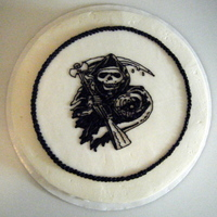 Sons Of Anarchy Logo Cake Chocolate cake with cream cheese filling. Sons of Anarchy logo piped by hand on top