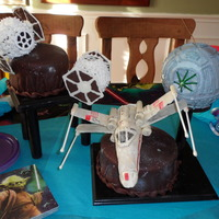 Death Star Battle The two space cakes are covered in modelling chocolate. I made the x wing fighter out of cereal treats and chocolate. The Emperial fighters...