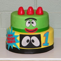 Yo Gabba Gabba This is a 10 inch with an 8 inch cake on top. The covering is MMF, and the other decorations are wilton fondant cut with a cricut cake. A...