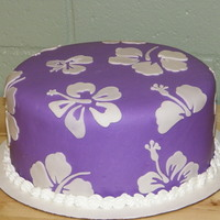 Hibiscus Cake 10 inch double layer cake. The purple is MMF. The white flowers are made from wilton fondant and cut with a cricut cake using Make the Cut...