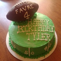 Football Birthday Cake The football is made of rice crispies and covered in chocolate.