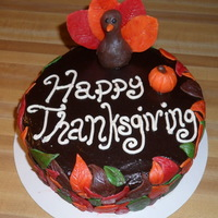 Thanksgiving Cake Chocolate ganache cake covered with modeling chocolate leaves