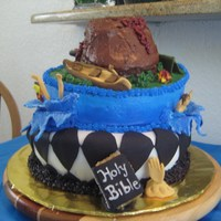 Topsy Turvey Cake my 1st attempt with a topsy turvey cake. The cake represents my son's senior year All done with fondant & butercream.