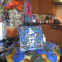 Colorflow The coat of arms, back of throne & roosters are made with colorflow icing. The rest is fondant & buttercream. Jewels & coins...