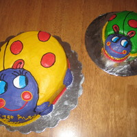 Ladybugs My granddaughter's 1st b'day cakes (1 for her & the other for the guest). The large one was done w/ a Wilton pan & small...