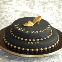 Black And Gold  A 40th birthday cake for a friend's Black Tie and Tiara party. Chocolate devil's food cake on the bottom and milk choc sponge on...