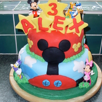 Mickey Mouse Clubhouse i was browsing through cakecentral for inspiration and my son saw a mickeymouse cake and had to have it! sorry i cant remember who did it...