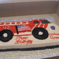Fire Truck Birthday Cake Used regular wilton firetruck cake pan. The flag is is RI trying to make it look like the fire truck they went and visited for the party