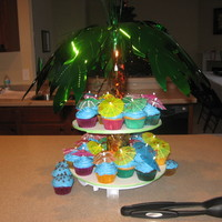 Tropical Cupcakes Made for a Christmas in Hawaii party. The cupcake stand is my sons bottle drying rack made over.