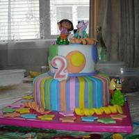 Dora The Explorer Cake My first attempt at a 2 tiered cake. All decorations are made from fondant. The Dora, boots and swiper are toys I bought