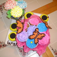 Cupcake Flower Bouquet With Butterflies This was for my grandmothers birthday. They are Vanilla bean cupcakes with a strawberry filling and buttercream. The main flower bouquet is...