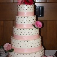 Swiss Dots And Ribbon Wedding Cake 14, 12, 10, 8, 6 round tiers, iced in IMBC, satin ribbon, and swiss dots.