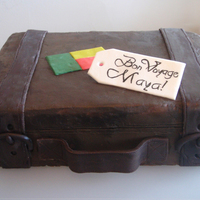 Suitcase Cake Buttercream with fondant accents and gumpaste tag. Made for a going away party. The flag is from Benin. I had a lot of fun doing this cake...