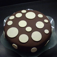 Chocoate Circles orange chocolate cake with rolled chocolate fondant, with white chocolate circles.