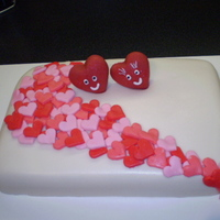 Cascading Hearts lemon cake with raspberry filling, rolled BC covered with rolled BC hearts. 2 hearts on top made from fondant.