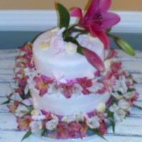 Mini Wedding Cake I made this for a friends sister who had a small wedding on the beach. The flowers are real, it was a yellow cake covered in fondant with...