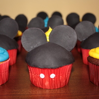 Mickey Mouse Birthday! White and chocolate cupcakes with buttercream icing. Fondant Mickey Mouse head and ears. Made to match the birthday boy's party!