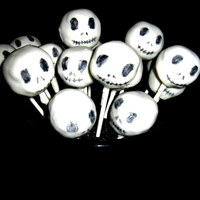 Jack Skellington Cake Pops Spice cake and cream cheese frosting cake pops dipped in white chocolate. Faces were drawn on with food writers.