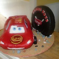 Lightning Mcqueen Car Cake Lightning McQueen car and tire on a sandy road