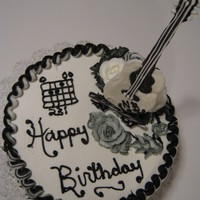 Chocolate Guitar & Chocolate Cake A 21st. Birthday Cake for a man that plays guitar .. this cake was fun to do .. I had troubles with the strings breaking but I got my 3...