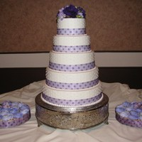 Lavender Cake With Dots And Cupcakes All buttercream, bride's ribbon and flowers.