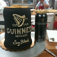 Guinness Beer Can Guinness beer can covered in black fondant. Then piped with glaze and painted with gold luster dust mixed with vodka