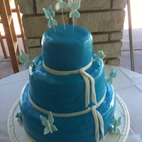 Blue Butterfly Wedding Cake This wedding cake is covered in blue fondant with white bands and white butterflies. Held at a public park in Kaukauna Wisconsin