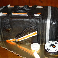 Hockey Bag 50Th Birthday  This cake was inspired by natskys version. Thanks for sharing it. A thick layer of buttercream under a thick layer of mmf allow me to add...