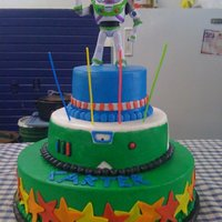 Buzz Lightyear Buttercream, with fondant stars and caution line on top layer