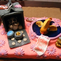 Pet Store Birthday Cake My friend's niece asked her for a hamster and a fish for her birthday.The living kind was veto'd by her momma so she got the next...