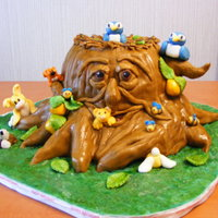 Happy Tree Cake The tree is cake covered in fondant, all the animals and decorations are fondant.