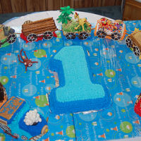 Animal Train Cake My daughter made the train cake, I only made the characters from his nursery.It's become a family tradition, all our children get a...