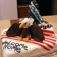 Welcome Home & Christmas Cake The eagle's body is made out of chocolate, everything else is fondant.