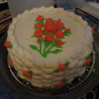 Rosette Bouquets This is my first two teired cake, with chocolate pudding filling. Buttercream frosting and a basketweave trimmin g! I hope u like it, I did...