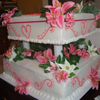 My First Two Tiered Cake With Royal Icing Tiger Lillies I made this cake as a surprise for my pastor and his wife from the church. This is my very first official cake for someone else! I am...