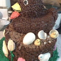 Chocolate Hen In Basket With Chocolate Molded Chicks, Eggs And Tulips triple chocolate cake with chocolate chicks, eggs, and tulips!