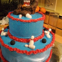 Domo/bowling Cake This is a white cake with buttercream icing and fondant bowling pins and balls. Domo is a rice crispy treat dipped in mild chocolate. I...
