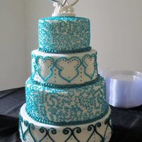 Teal Wedding Cake   Buttercream...Cornelli Lace & random patterned tiers