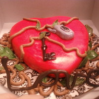 You Have The Key To My Heart! This is a milk chocolate cake with raspberry filling. It is covered in MMF and sourrounded by edible vines and leaves with a chocolate LOVE...