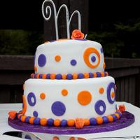 Purple & Orange Polka Dot Wedding Cake The bottom is a 10 inch and the top is an 8 inch round.