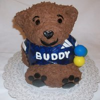 Bear Cake This is a build a bear cake. This was covered in chocolate frosting and the clothes and eveything else was made out of fondant.