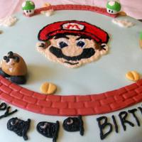Mario Brother Cake This is a Mario brothers 10 inch round cake.