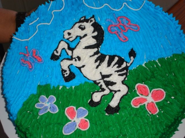 Zebra Fun This cake was for a 6 yo birthday party. Buttercream icing used vanilla instead of butter flavor....the cake was a hawiian wedding cake.......