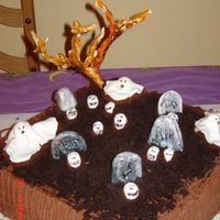 Graveyard.jpg Grave Yard Cake....triple chocolate cake w chocolate buttercream icing.....The ghost, skulls, tumbstones,tree and dirt all edible.....I...