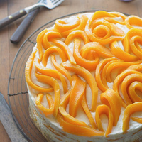 Mango-Misu Trifle Cake A mango version of tiramisu with alternating layers of ladyfingers soaked in orange liqueur and mascarpone whipped cream, then topped with...